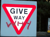 Antisocial Behaviour showing graffiti on road sign