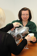Occupational Therapist Demonstrating how to use a Kettle Tipper