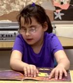 Girl reading braille